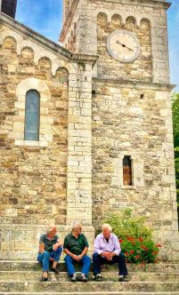 Italian men catching up in front the the church